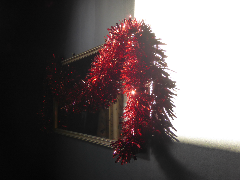 Red tinsel in the sunlight
