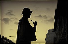 Silhouette of Sherlock Holmes with pipe and hat