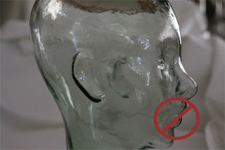 glass head model with circle and line symbol over mouth