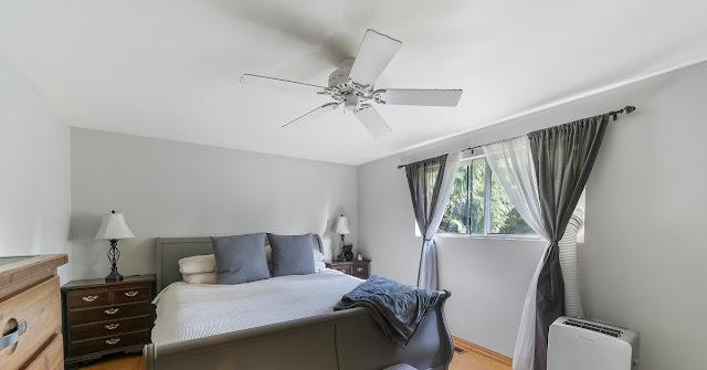 Traditional fan in a bedroom.
