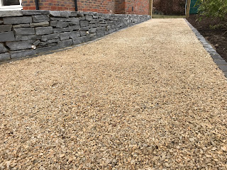 Slate wall and gravel driveway
