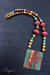 patinaed coper necklace with beads