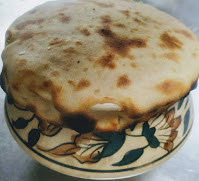 Dum pukht veg biryani  using wheat flour dough on a biryani pot