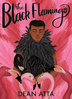 A young Black man in a black feather boa with a black flamingo in front of him, surrounded by pink flamingo feathers with a small group of pink flamingos in front of him and the black flamingo.