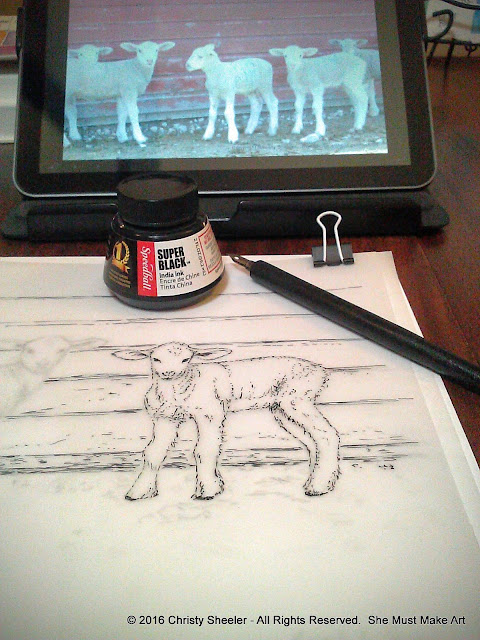The ink drawing of a lamb on thick parchment paper and the photo reference in the background.