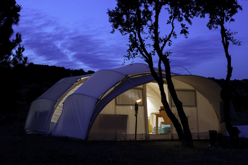 Ctents Glamping luxury tent at night spacious and quiet