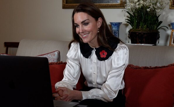 Ghost London Boo blouse. Kate Middleton wore a new satin ivory Peter Pan–style collar blouse from Ghost London. Kate is wearing pearl earrings