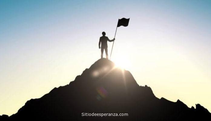 Hombre en la cima del éxito