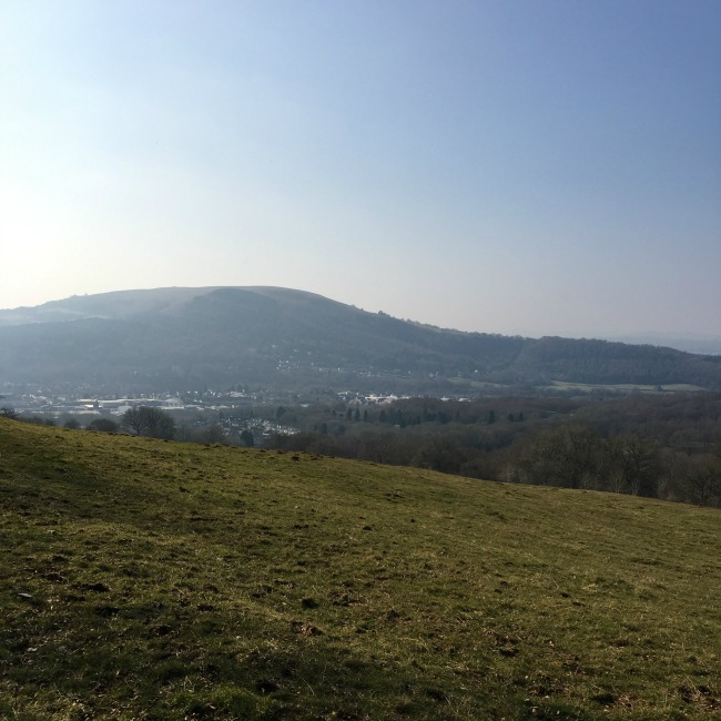 view across grass towards mountain and town, Caerphilly, in the valley