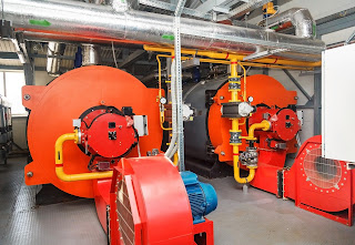 gas fired boilers in machinery room