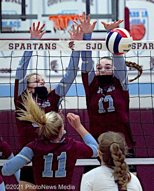 Taylor Wells and Becca Becca Steinbach go up for a block