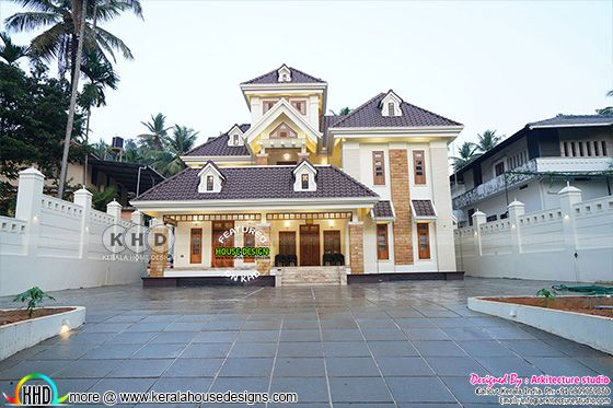 Superb looking real life photograph of Kerala style sloping roof house in day light view