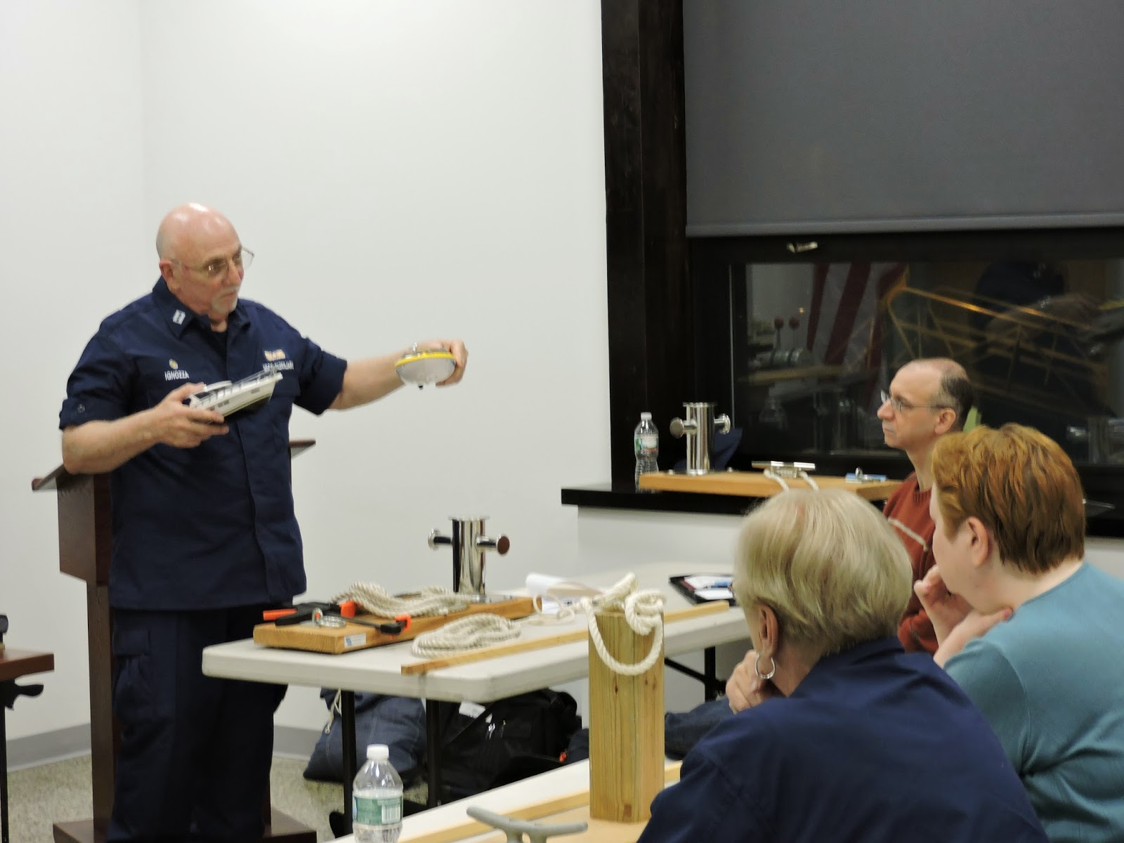 John Ignozza, Instructor from Flotilla 16-07, uses model boats to demonstrate who has to yield the right of way on the water.