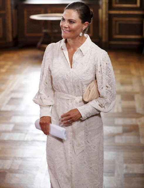 Crown Princess Victoria wore a libby shirt dress by Valerie Stockholm. Cravingfor earrings. Chanel clutch. Gianvito Rossi