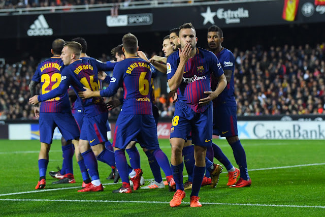 Barcelona players celebrates Alba's equalizer against Valencia