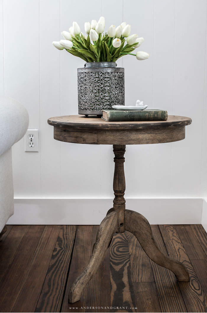 Wood accent table with tulips