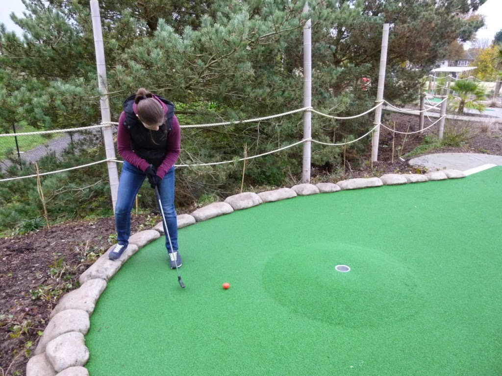 Emily Gottfried on the tricky 17th hole plateau volcano at Jungle Island Adventure Golf at Horton Park Golf Club in Epsom, Surrey