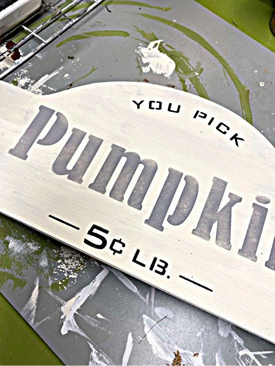 Stenciled pumpkin sign