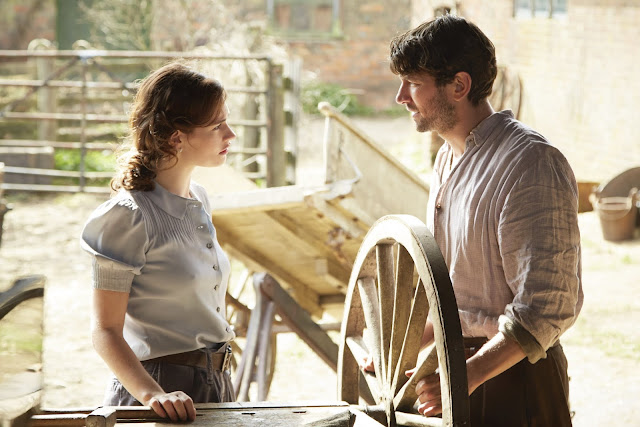 First Look The Guernsey Literary And Potato Peel Pie Society Lily James as Juliet Ashton & Michiel Huisman as Dawsey Adams