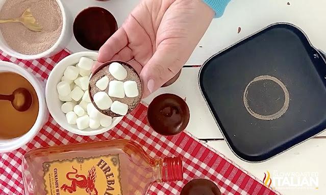 adding marshmallows to chocolate half