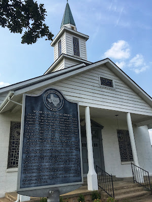 state historical marker texas in front of white church with steeple