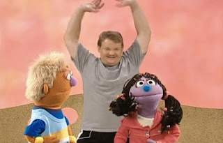 Andy Ritcher demonstrates methods of moving our body. Sesame Street Happy Healthy Monsters