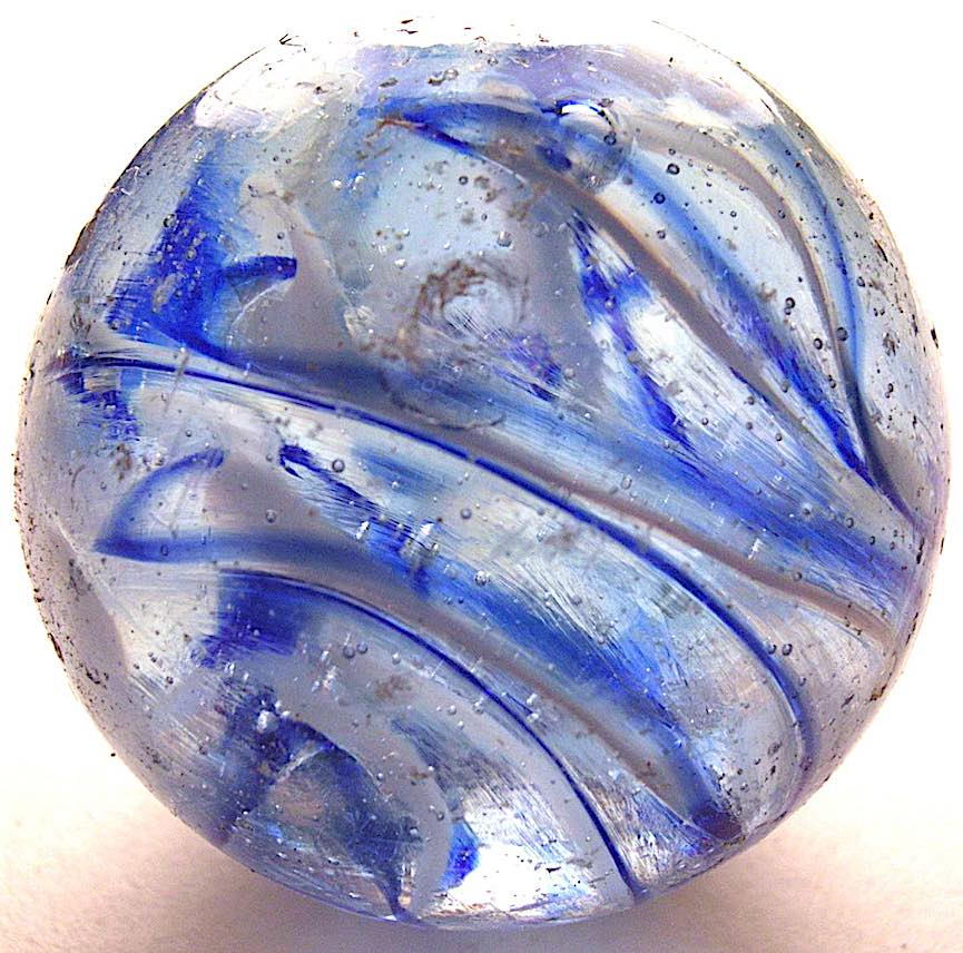 a child's glass marble with blue streaks