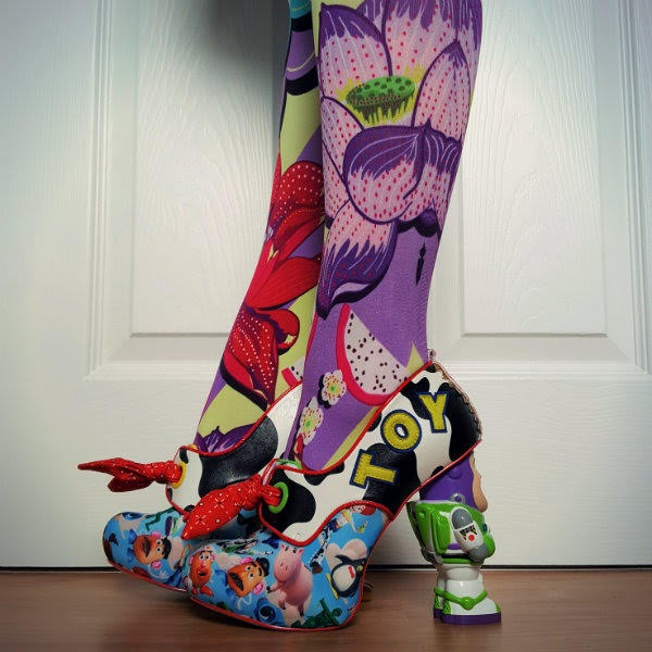 side view of legs wearing floral fashion tights and Toy Story printed cow print shoes