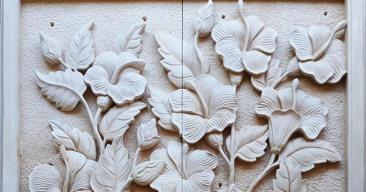 Relief Batu Putih Gambar Motif Bunga Sepatu
