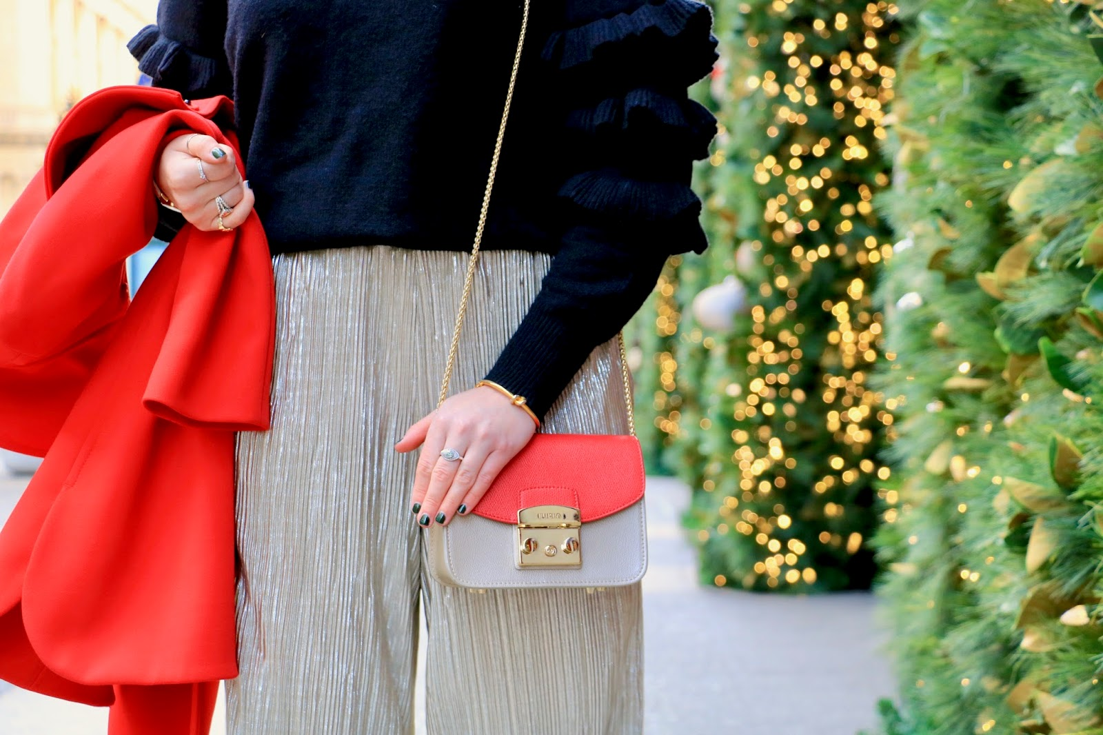 Nyc fashion blogger Kathleen Harper showing how to wear a ruffle sweater