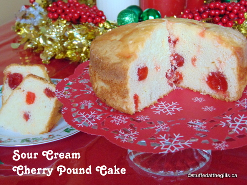 Sour Cream Cherry Pound Cake on cake stand with slices on a plate.