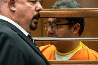 Naason Joaquin Garcia, the leader of fundamentalist Mexico-based church La Luz del Mundo listens to a court appointed translator in Los Angeles County Superior Court