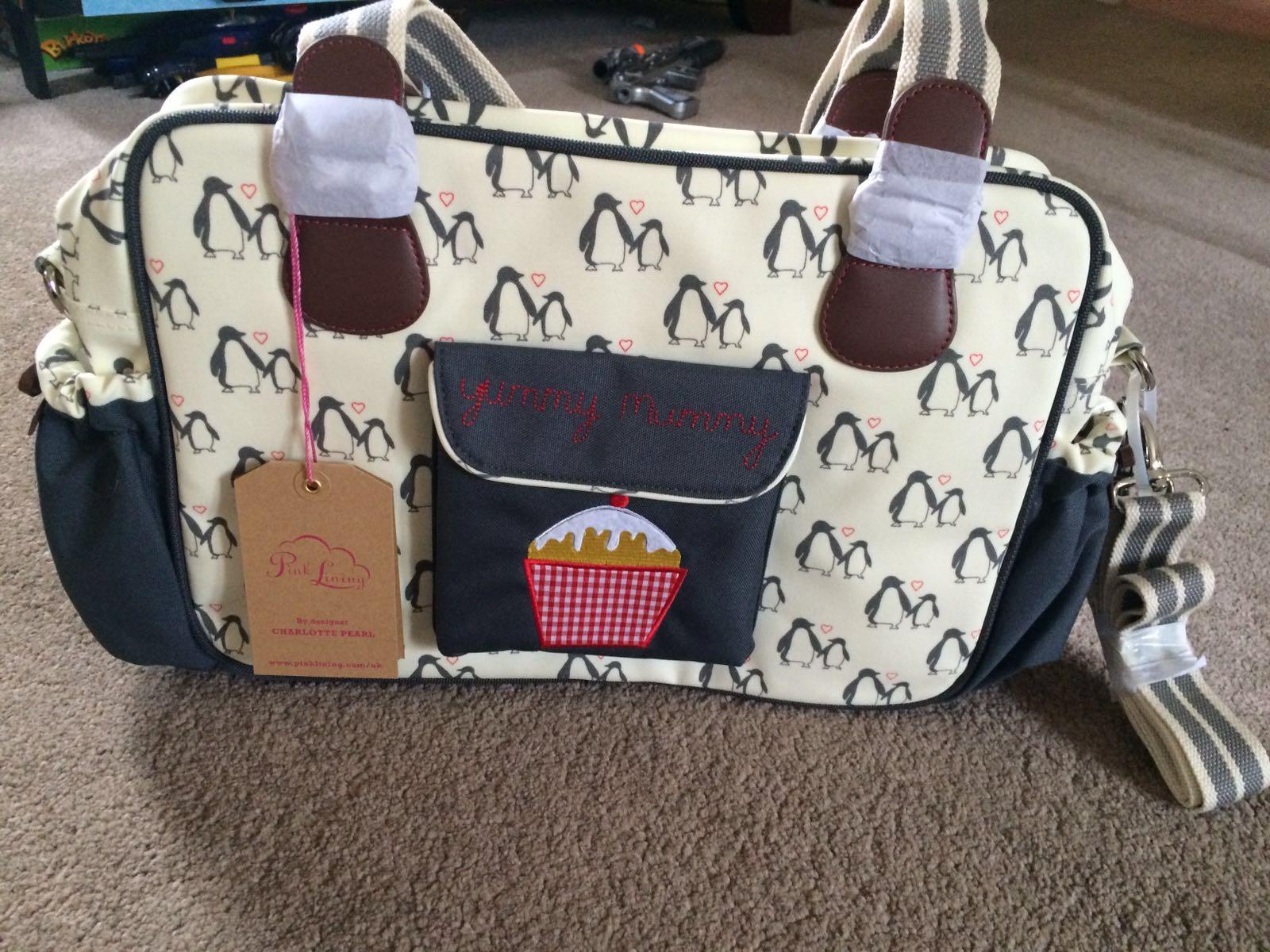 pink lining yummy mummy changing bag penguin love bag. Black Bedroom Furniture Sets. Home Design Ideas