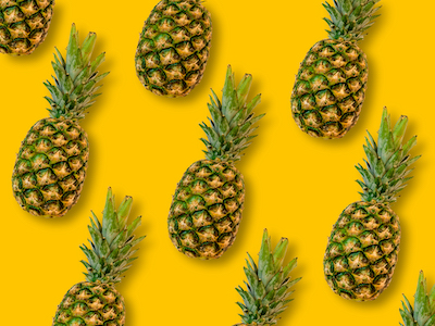 Pineapples pattern on yellow background