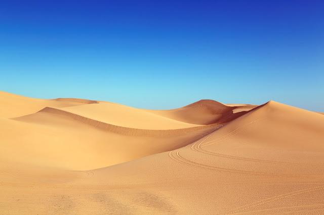 Sand and Blue Sky at  Sahara Desert