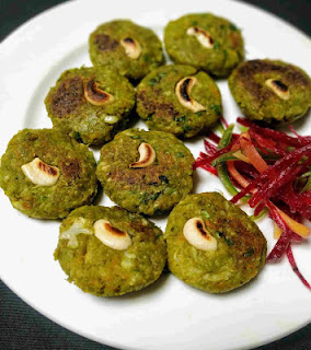 Round shaped hara bhara kabab with cashewnut at centre