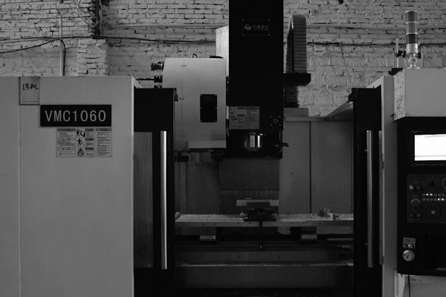 What are the advantages and disadvantages of CNC machining centers?