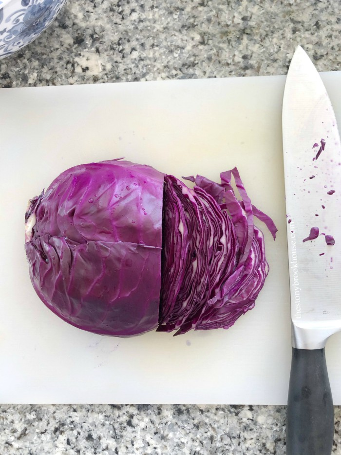 Cutting cabbage into thin slices