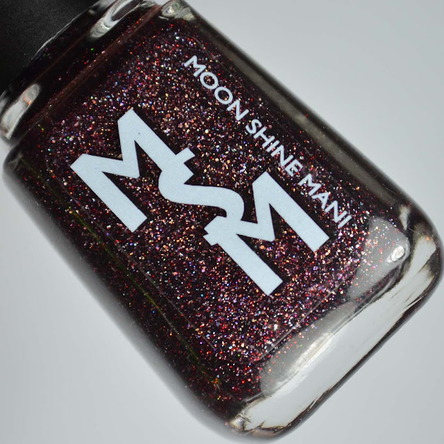 blackberry glitter nail polish in a bottle