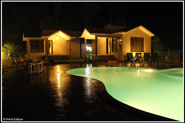 Pool and cottage of Kingfisher Resort, Kanha