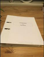 Arbeidsmappe for å holde orden på notatene til bokprosjektet.