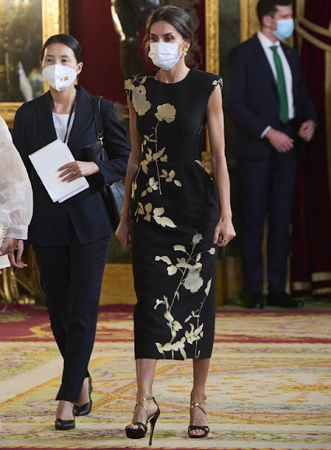 Queen Letizia wore a sequin embellished metallic floral print jacquard midi dress from Dries van Noten. First Lady Kim Jung-sook