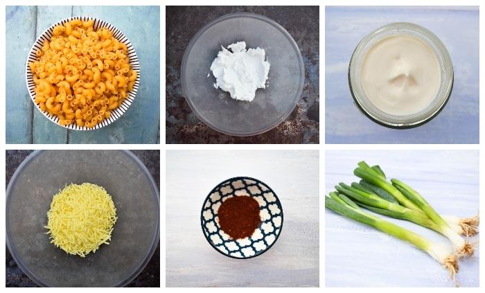 Ingredients to make creamy cheese pasta salad - macaroni, vegan cheddar, vegan cream cheese, vegan mayo, paprika & spring onions
