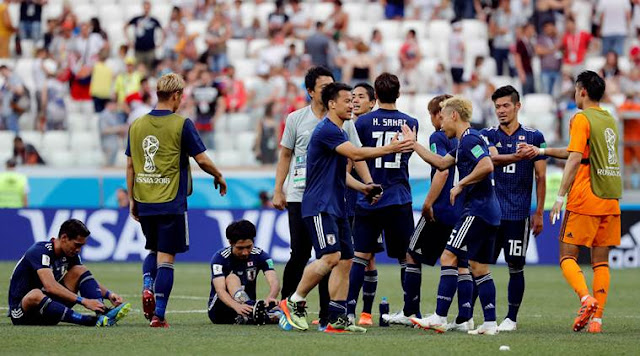 Japan players celebrate after the match