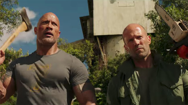 Dwayne Johnson with an axe and Jason Statham with a chainsaw
