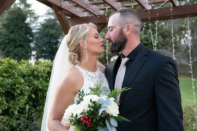 Closeup of Bride and Groom about to kiss Magnolia Farm Asheville Wedding Photography captured by Houghton Photography