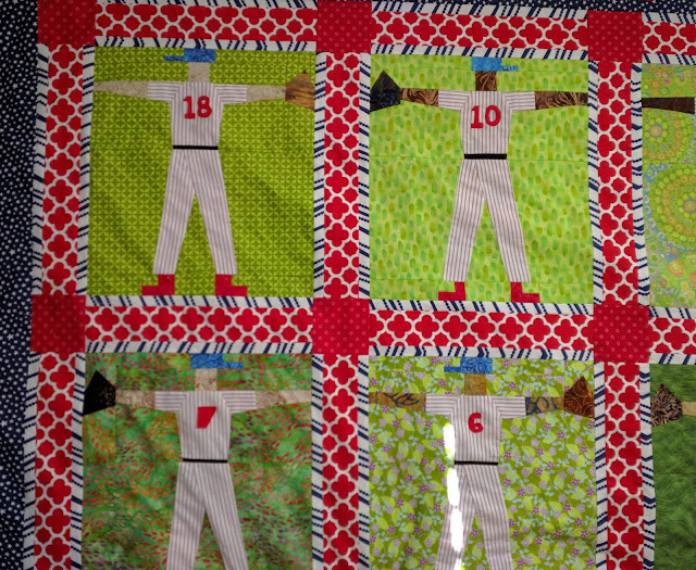Player numbers appliqued on jerseys of Phillies baseball quilt.