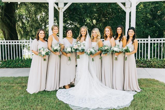bride and bridesmaids in dark cream grey