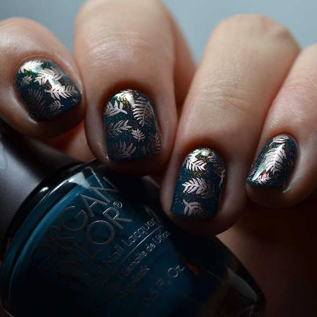 teal nail polish with gold frond stamping and rainbow shimmer swatch