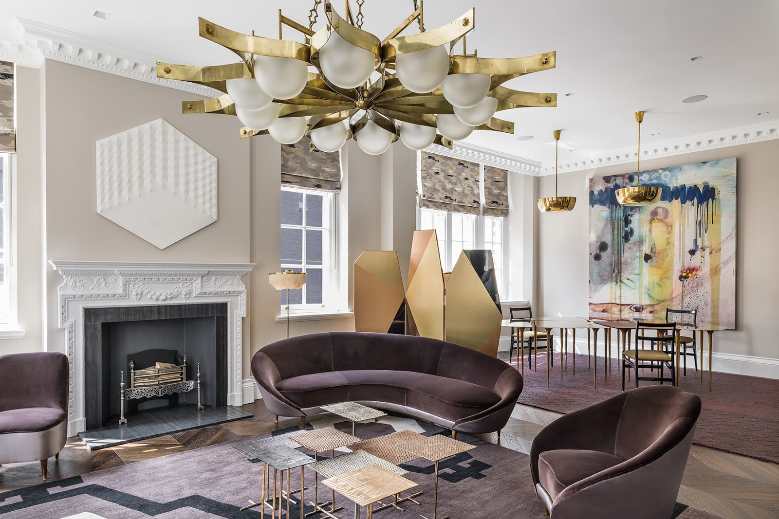 Luxurious eclectic London apartment with pattern geometric rugs, mid century modern furniture and art, old fireplace